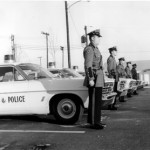 Henrico Police vintage photo of officers at attention in front of early model police vehicles