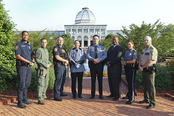 Eight Henrico police officers standing in varied uniforms at Lewis Ginter Botanical Gardens