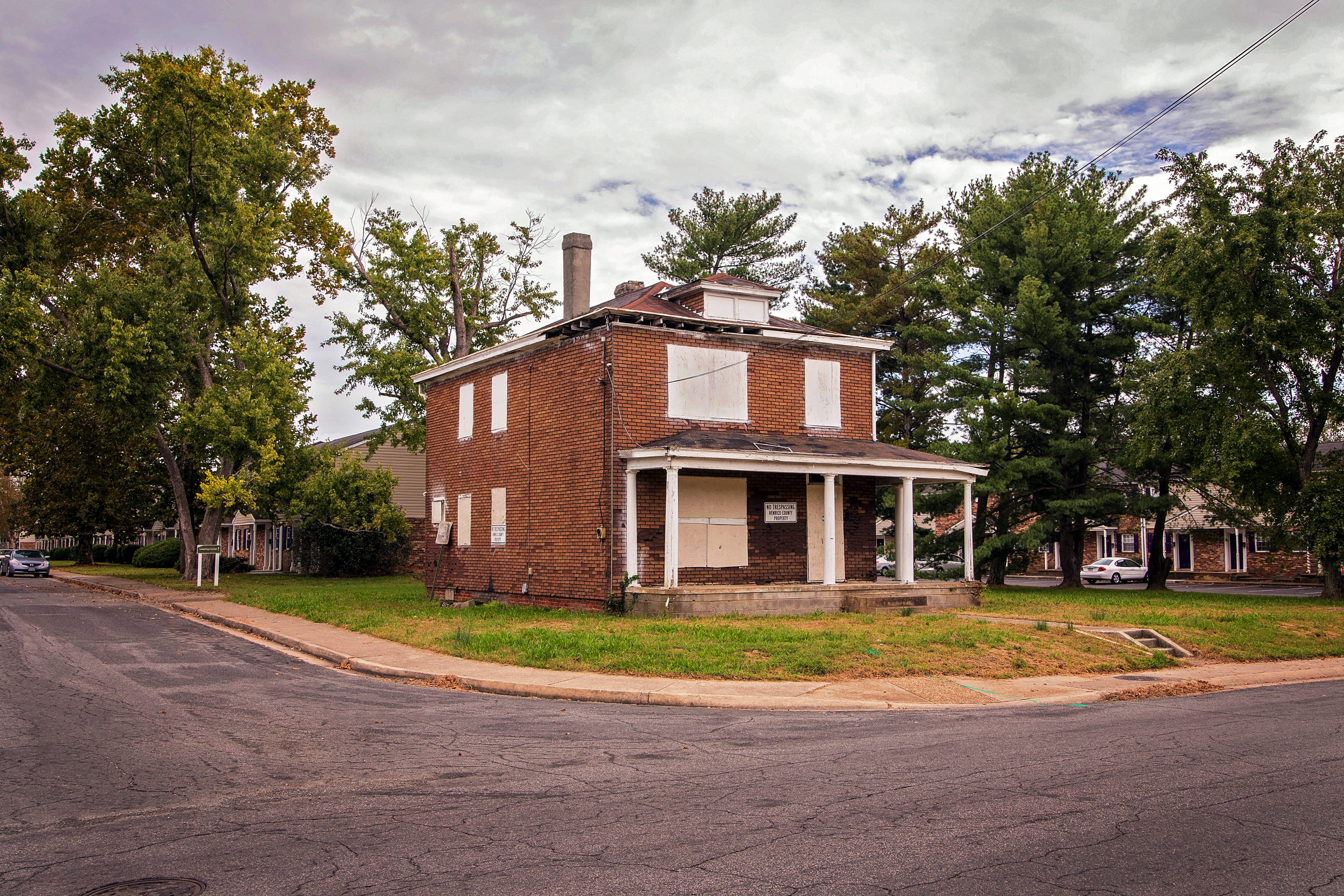 Brick house with boarded up windows