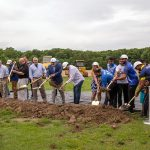 Group shoveling dirt for groundbreaking