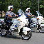 Two Police Motorcycle units in motion on roadway